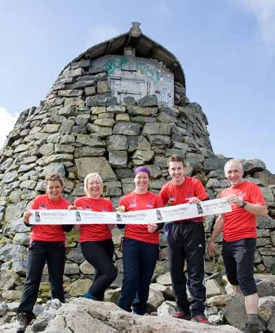 Group doing the 3 peaks challenhge for hearing dogs on Ben Nevis summit